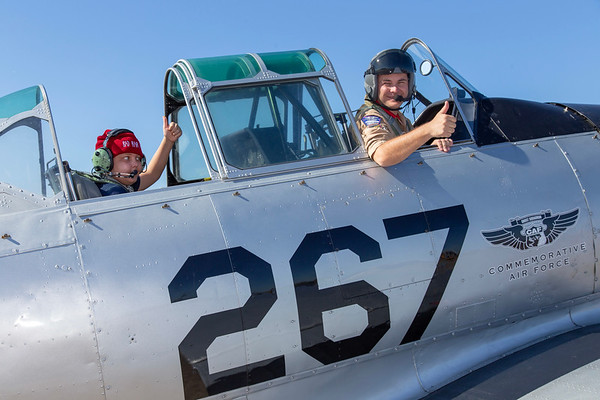 """Passenger Rutger and pilot Dave Olivier give a """"thumbs up"""" prior to engine start in a CAF T-6 Texan."""