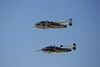 """Two B-25 Mitchell Bombers:  """"Yellow Rose"""" at top; """"Show Me"""" below."""