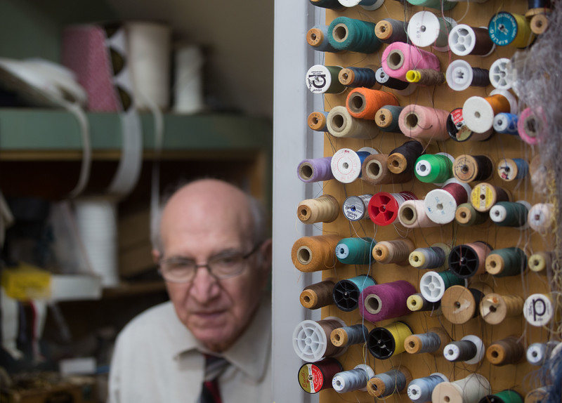 "November 12, 2016. ""I have a basement and drawers full of thread and buttons and stuff,"" Dino says. He gets most of it from stores but some of it is taken from old clothing. <br /> Dino Sicicchia (cq), 72, an immigrant from Italy, owns a tailor shop on Monroe Ave. in Rochester, N.Y. that he has worked in for 18 years. Dino makes all of the income between he and his wife. Dino works in his shop six days a week from 8 a.m. to 6 p.m. Dino is considered a hero to his wife for the long hours and many days he works to provide the necessary income for his family."