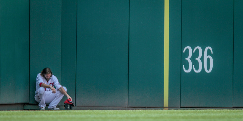 July 24, 2016. Jason Werth takes a seat in the outfield in the shade. Washington Nationals play San Diego Padres at Nationals Park, Washington D.C.