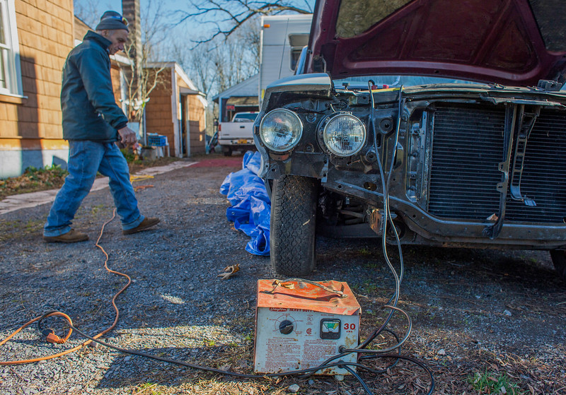 November 14, 2016. Dominick plugs up a battery charger to the 1964 Ford LTE so he can move it closer to the garage. Dominick does more than just body work, he also is a mechanic that does everything from changing the oil to fixing engines.<br /> Dominick DeSantis, 69, refurbishes cars at his home garage in Kirkville, N.Y. DeSantis acquired a permit to work on cars in his garage after working at a four car garage down the road. Neighbors around the small town always come to DeSantis for car repair because of his lower prices.