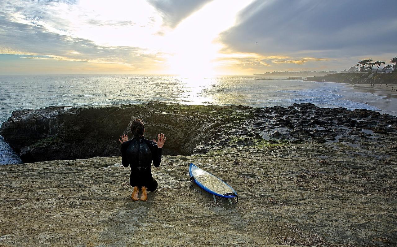 Surfer Praying.  Santa Cruz Beach.