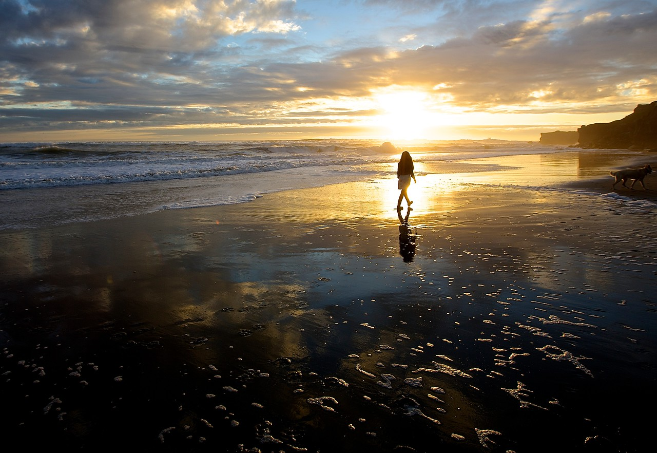 Girl  In The Sunset.  Santa Cruz Beach