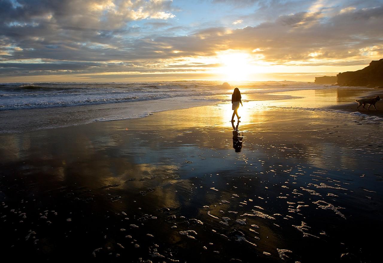 Girl  In The Sunset.  Santa Cruz Beach