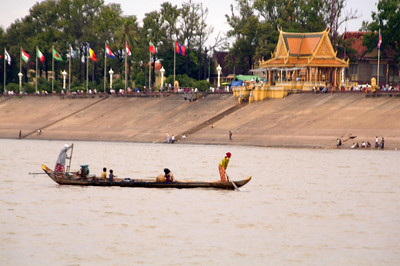 Embassey Flags ..waving in the welcomed breeze along the waterfront of the Tonle Sap River