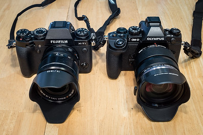 Fuji X-T1 size with 18-55mm f/2.8 to f/4 lens compared to Olympus E-M1 with 12-40mm f/2.8