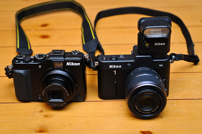 Nikon P7000 point and shoot camera (left) compared to NIkon V1 interchangeable lens camera (right)