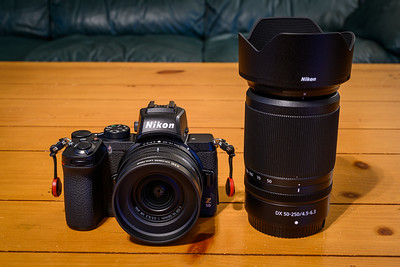 Nikon Z50 with 16-50mm kit lens attached.  50-250mm kit lens on the right.
