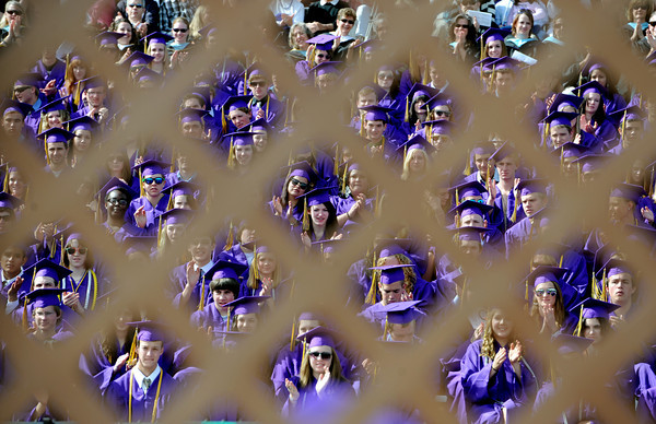 "Boulder High School 2011 graduates are seen through the lattice work   on the stage at Recht Field on Saturday.<br /> For a video and photos of the graduations, go to  <a href=""http://www.dailycamera.com"">http://www.dailycamera.com</a>.<br /> Cliff Grassmick/ May 21, 2011"
