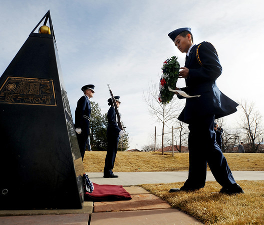 "Challenger Memorial 201190 .JPG  Cadet John Nguyen places a wreath at the Ellison Onizuka Memorial during the ceremony. Onizuka was a CU graduate.<br /> Air Force ROTC cadets at the University of Colorado held a memorial to honor the crews of Challenger and Columbia space shuttle disasters on Saturday on campus. For more photos and a video of the ceremony, go to  <a href=""http://www.dailycamera.com"">http://www.dailycamera.com</a>.<br /> Cliff Grassmick/ January 29, 2011"