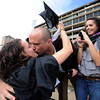 "Andrew Dudderar gives his graduate girlfriend, Brittney Gaillot, a kiss before the ceremony, as sister Kelesey Gaillot, looks on. <br /> A total of 5,897 degrees were conferred during the University of Colorado Spring 2011 Commencement on Friday at Folsom Field in Boulder, Colo.<br /> For more photos and a video of graduation, go to  <a href=""http://www.dailycamera.com"">http://www.dailycamera.com</a>.<br /> Cliff Grassmick/ May 6, 2011"