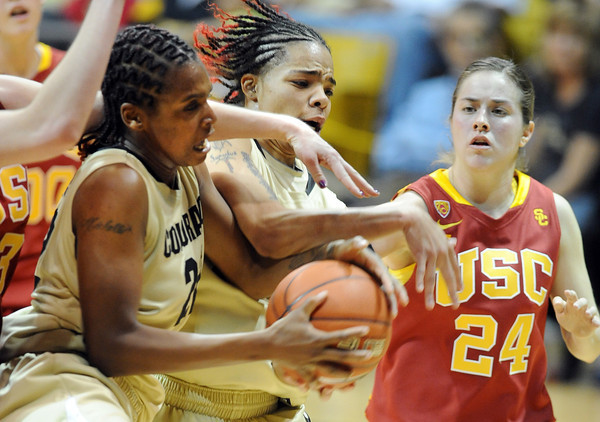 Brittany Spears, left, Chucky Jeffery, both of Colorado, and Ashley Corral of Southern California, attempt to get the rebound during the second half of the March 27, 2011 game in Boulder.<br /> Cliff Grassmick / March 27, 2011
