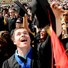 "Alex Schultz, a gradaute of the School of Journalism, throws his cap in the air  at the end of the ceremony.<br /> A total of 5,897 degrees were conferred during the University of Colorado Spring 2011 Commencement on Friday.<br /> For more photos and a video of graduation, go to  <a href=""http://www.dailycamera.com"">http://www.dailycamera.com</a>.<br /> Cliff Grassmick/ May 6, 2011"