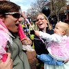 "Kaia Wall, 13 months, puts a spell on her dad, Clint, with her magic wand during the parade. Kirsten Wall is holding Kaia and Sierra is on dad's shoulders.<br /> The annual Tulip Fairy and Elf Parade took place on the Pearl Street Mall on Saturday.<br /> For a video of the parade,  go to  <a href=""http://www.dailycamera.com"">http://www.dailycamera.com</a>.<br /> Cliff Grassmick/ April 23, 2011"