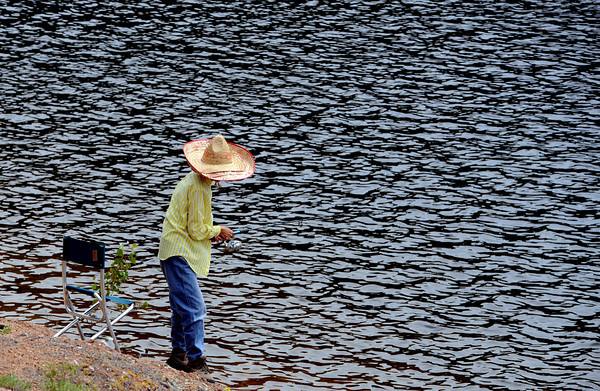 "Margie Lin of Denver fishes at Gross Reservoir with her sombrero to block the sun.<br /> A handfull of fishermen had a quiet day at Gross Reservoir on Wednesday.<br /> FOR MORE PHOTOS OF GROSS RESERVOIR GO TO  <a href=""http://WWW.DAILYCAMERA.COM"">http://WWW.DAILYCAMERA.COM</a><br /> Cliff Grassmick / July 6, 2011"