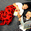 "Jose Gutierrez, left, and Dominic Lucero, both 3rd-graders at Sanchez Elementary, read a book during pajama day at the school.<br /> Sanchez Elementary in Lafayette,  one of two Boulder Valley schools with the highest percentages of low-income students, created a new vision for the school, hired 14 new teachers and started its own foundation.<br /> For a video of the Sanchez awards, go to  <a href=""http://www.dailycamera.com"">http://www.dailycamera.com</a><br /> December 16, 2011 / Cliff Grassmick"