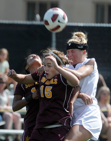 "Holland Crook (15) of ASU, and Amy Barczuk of CU, go up to connect on the header.<br /> For more photos of the game, go to  <a href=""http://www.dailycamera.com"">http://www.dailycamera.com</a><br /> Cliff Grassmick / October 2, 2011"