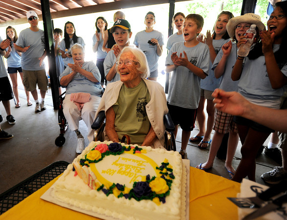 """Berenice Sayre  finishes blowing out the candles on her cake during the celebration.<br /> Berenice Sayre of Boulder turned 100 years-old in February. She celebrated her birthday during a family reunion with over 60 relatives at North Boulder Park.<br /> For more photos and a video of the celebration, go to  <a href=""""http://www.dailycamera.com"""">http://www.dailycamera.com</a>.<br /> Cliff Grassmick / July 2, 2011"""