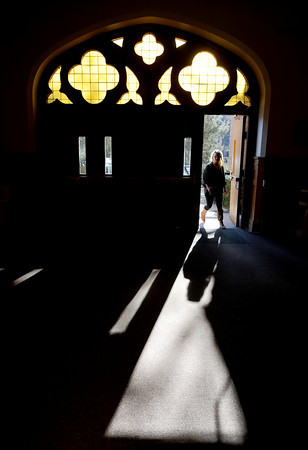 Sara Pearson, a CU senior in film studies, enters Macky Auditorium on Tuesday to work on a project.<br /> University of Colorado students work during finals week.<br /> December 13, 2011 / Cliff Grassmick