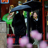 Hannah Schenberg, right, walks along the Pearl Street Mall past Goldmine Vintage clothing store with an unidentified man in the rain on Wednesday.<br /> Cliff Grassmick/ May 11, 2011