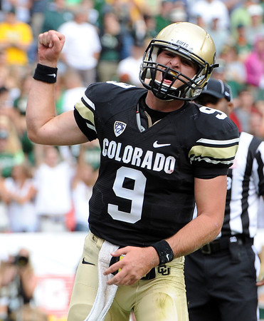 "Tyler Hansen of CU celebrates his second TD against CSU.<br /> For more photos of the CU game, go to  <a href=""http://www.dailycamera.com"">http://www.dailycamera.com</a>.<br />  Cliff Grassmick / September 17, 2011"