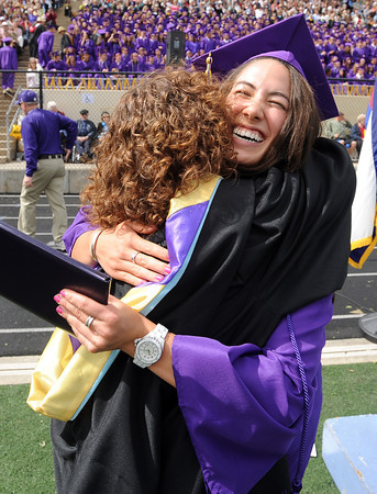 """Boulder High graduate, Kalina Grabb, has a huge hug for assistant principal, Shannon Minch, after she received her diploma on Saturday.<br /> For a video and photos of the graduations, go to  <a href=""""http://www.dailycamera.com"""">http://www.dailycamera.com</a>.<br /> Cliff Grassmick/ May 21, 2011"""