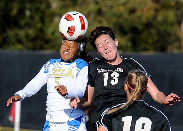 """Zakiya Bywaters, left, of UCLA, and Kate Russell of CU, go up to hit the ball on Friday.<br /> For more photos of the game, go to  <a href=""""http://www.dailycamera.com"""">http://www.dailycamera.com</a>.<br /> Cliff Grassmick / October 28, 2011"""