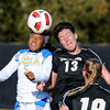 "Zakiya Bywaters, left, of UCLA, and Kate Russell of CU, go up to hit the ball on Friday.<br /> For more photos of the game, go to  <a href=""http://www.dailycamera.com"">http://www.dailycamera.com</a>.<br /> Cliff Grassmick / October 28, 2011"