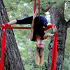 Sarah Gray, of Chattanooga, TN, works on an aerial dance routine in Eben G. Fine Park in Boulder on Wednesday. <br /> Cliff Grassmick / August 24, 2011