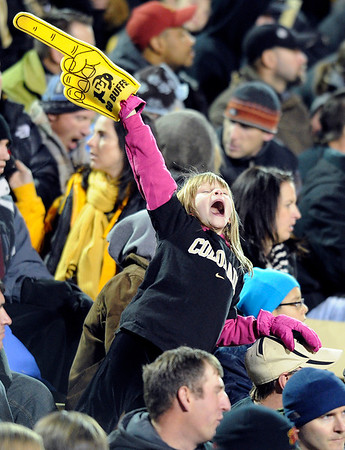 """Juliana Ravin, 9, cheers for the University of Colorado on Friday, Nov. 4, during a football game against the University of Southern California at Folsom Field on the CU campus in Boulder. CU lost the game 42-17. For more photos of the game go to  <a href=""""http://www.dailycamera.com"""">http://www.dailycamera.com</a><br /> Jeremy Papasso/ Camera"""