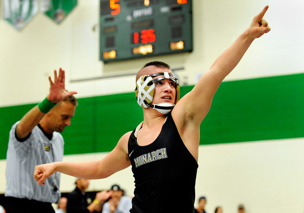 Monarch High School wrestler Jared Ferrera points to the crowd after defeating Longmont's Aaron Shaffer during the Boulder Valley Invitational wrestling meet on Saturday, Jan. 8, at Niwot High School. Ferrera won by points after three periods.<br /> Jeremy Papasso/ Camera
