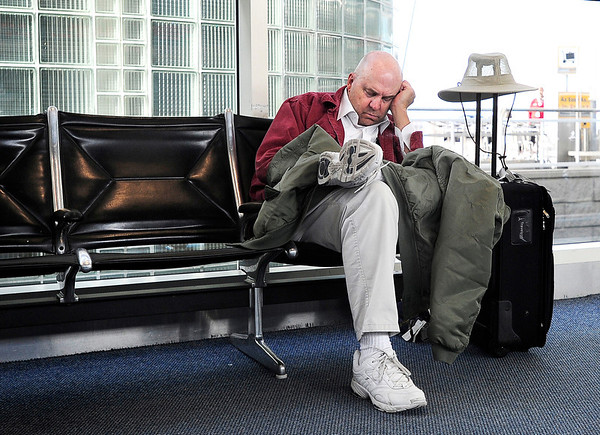 "Holiday Travel at DIA001.JPG Dan Phillippi, of Sacramento, CA., takes a nap while waiting for his son to pick him up on Wednesday, Nov. 23, at Denver International Airport. For a video of people traveling for Thanksgiving go to  <a href=""http://www.dailycamera.com"">http://www.dailycamera.com</a><br /> Jeremy Papasso/ Camera"