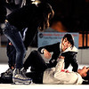 Doricela Zamora, 13, left, Pitah Vasquera, 13, laughs with Melissa Castruita, 13, after falling down while ice skating on Thursday, Dec. 8, at the Boulder Ice Rink on 13th Street in Boulder.<br /> Jeremy Papasso/ Camera