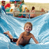 Elijah Crepeau, 5, of Firestone, has some fun on a water slide on Friday, July 29, during A Gunbarrel Community Picnic and Celebration at the Vine Life Church in Gunbarrel.<br /> Jeremy Papasso/ Camera