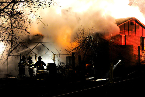 Boulder firefighters work to put out a structure fire near the intersection of 30th Street and Euclid Avenue in Boulder on Saturday, Nov. 19.<br />  Jeremy Papasso/ Camera