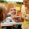"Boulder Creek Fair001.JPG Maddie Lamphere, 10, of Boulder, smiles in the mirror as Amber Jarvis shows her face painting skills on Saturday, Sept. 3, during the Boulder Creek Hometown Fair in Boulder. For more photos and video of the fair go to  <a href=""http://www.dailycamera.com"">http://www.dailycamera.com</a><br /> Jeremy Papasso/ Camera"