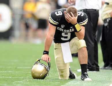 University of Colorado quarterback Tyler Hansen shows his emotion after losing the game on Saturday, Oct. 1, against Washington State at Folsom Field in Boulder. CU lost the game 31-27. For more photos of the game go to www.dailycamera.com Jeremy Papasso/ Camera