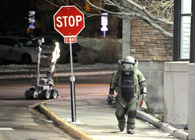 A Boulder police officer works to detonate a suspicious package near the Euclid parking lot on Friday, Feb. 4, on the University of Colorado campus. The device to the left is a robot used to detonate bombs. Jeremy Papasso/ Camera