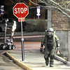 A Boulder police officer works to detonate a suspicious package near the Euclid parking lot on Friday, Feb. 4, on the University of Colorado campus. The device to the left is a robot used to detonate bombs.<br /> Jeremy Papasso/ Camera