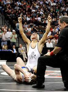 Pueblo South High School wrestler Robert Deherrera shows his emotion after defeating Broomfield's Cortland Hacker during the Colorado State Class 4A 125-pound championship match on Saturday, Feb. 19, at the Pepsi Center in Denver. Photo by Jeremy Papasso