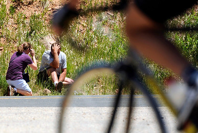 A woman consoles the man responsible for crashing into a bicyclist on Friday, June 17, at the intersection of Old Stage Road and Lefthand Canyon Drive in Boulder County. The names of the two individuals were not given. FOR A VIDEO FROM THE SCENE OF THE ACCIDENT GO TO WWW.DAILYCAMERA.COM Jeremy Papasso/ Camera