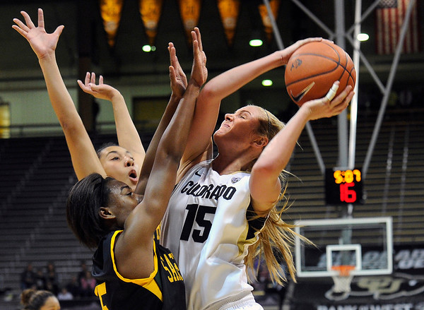 """University of Colorado's Julie Seabrook drives to the hoop over San Francisco defenders on Wednesday, Nov. 30, during a game against the University of San Francisco at the Coors Event Center on the CU campus in Boulder. For more photos of the game go to  <a href=""""http://www.dailycamera.com"""">http://www.dailycamera.com</a><br /> Photo by Jeremy Papasso"""
