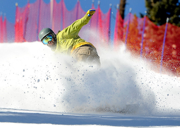 """Trevor Daugherty, of Nederland, sprays some snow while snowboarding on Friday, Nov. 18, during Eldora Mountain Resort's opening day. For more photos and video of opening day go to  <a href=""""http://www.dailycamera.com"""">http://www.dailycamera.com</a><br /> Jeremy Papasso/ Camera"""