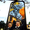 Buff's Stampede006.JPG Twin sisters Peggy Coppom, right, and Betty Hoover, both of Boulder, cheer with pom poms while riding on a fire truck decorated with University of Colorado logos during the Stampede on Friday, Sept. 16, on the Pearl Street Mall in Boulder.<br /> Jeremy Papasso/ Camera