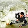 "Arapahoe Basin Ski Resort010.JPG Clayton Shaffer, of Westminster, goes down hard while attempting to skim across a pond on his snow skis on Friday, July 1, at Arapahoe Basin Ski Resort in Summit County.  For more photos and a video of the summer ski day go to  <a href=""http://www.dailycamera.com"">http://www.dailycamera.com</a><br /> Jeremy Papasso/ Camera"