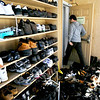 "A unidentified man walks past the stacks of shoes on Friday, Feb. 11, while going to pray at the Islamic Center of Boulder on Culver Court in Boulder. The Islamic Center is is hoping to raise enough money through the New Masjid Project to find a more adequate place to worship for Boulder County's growing Muslim population. For a video about the New Masjid Project go to  <a href=""http://www.dailycamera.com"">http://www.dailycamera.com</a><br /> Jeremy Papasso/ Camera"