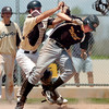 "Boulder's Kevin Flores, right, almost gets knocked down after being tagged out by Monarch catcher Greg Spurgin during a baseball game against on Sunday, July 24, at Monarch High School in Louisville. Boulder defeated Monarch 13-9. For more photos of the game go to  <a href=""http://www.dailycamera.com"">http://www.dailycamera.com</a><br /> Jeremy Papasso/ Camera"