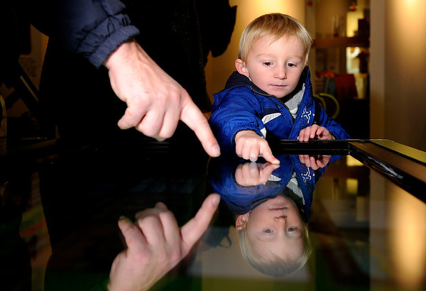 "Quinn Waite, 3, of Louisville, checks out a Discover Earth exhibit on Thursday, Nov. 17, at the Louisville Public Library on Spruce Street in Louisville. For a video explaining the Discover Earth traveling exhibit go to  <a href=""http://www.dailycamera.com"">http://www.dailycamera.com</a><br /> Jeremy Papasso/ Camera"