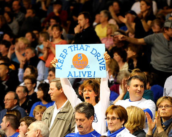 Nancy Prins, of Broomfield, holds up a sign to support her team during the Colorado High School Athletic Association girls class 4A championship game on Friday, March 11, at the Coors Events Center on the University of Colorado campus in Boulder. Broomfield defeated Longmont 48-38.<br /> Jeremy Papasso/ Camera
