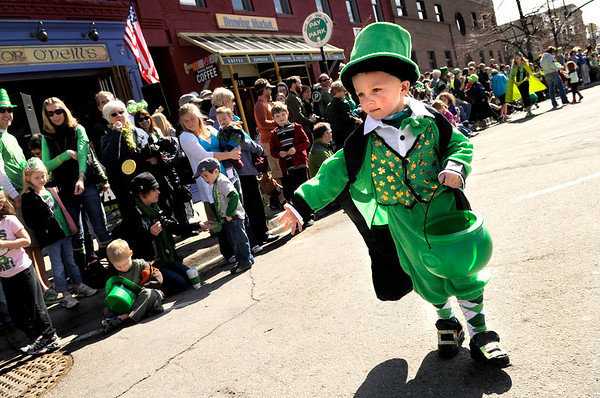 "St.PatricksDayParade002.JPG Grant Niemann, 4, of Lafayette, passes candy out to the crowd while dressed like a Leprechaun during the 2011 St. Patricks Day Parade on 13th Street in Boulder. For more photos and video of the event go to  <a href=""http://www.dailycamera.com"">http://www.dailycamera.com</a><br /> Jeremy Papasso/ Camera"